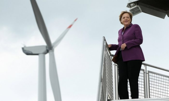 German Chancellor Angela Merkel pauses on a wind turbine platform while visiting a windpark on Aug. 18, 2010 in Krempin, Germany. Following Germany's decision to cut off its reliance on nuclear power, Munich is looking to make wind power one of its main electricity sources. (Sean Gallup/Getty Images)