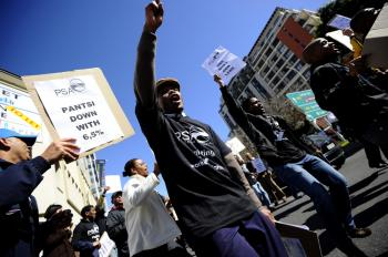 Dozens of public workers demonstrate on August 19, 2010 during their lunch break in support of the ongoing general strike in the Cape Town CBD in Cape Town, South Africa. (Gianluigi Guercia/AFP/Getty Images)