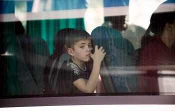 DEPORTEE: A young boy, belonging to the Roma community, arrives at Charles de Gaulle Airport, outside Paris, to fly back. (Fred Dufour/AFP/Getty Images)