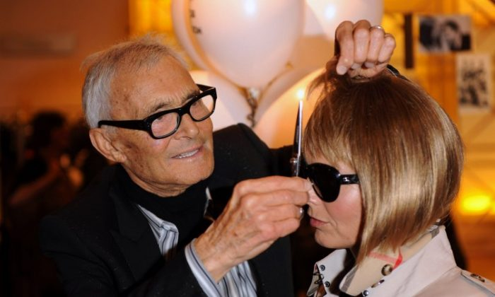 Vidal Sassoon attends his autobiography signing with an Anna Wintour lookalike at Selfridges department store on Sept. 8, 2010 in London. (Ian Gavan/Getty Images)