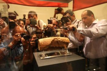 Photographers at the unveiling of the Cyrus Cylinder at the National Museum of Iran in Tehran last year. The artefact dating from the 6th century BC has been returned on loan to Iran by the British Museum in London. (Atta Kenare/AFP/Getty Images)
