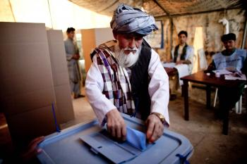 An Afghan man votes at a polling station for the parliamentary elections on Sept. 18 in Mazar-e-Sharif, Balkh Province, north of Kabul, Afghanistan. (Majid Saeedi/Getty Images)
