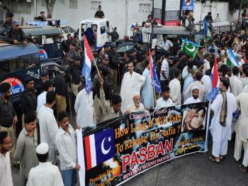Pakistani police block a street toward the US consulate during a protest rally by political parties and human rights activists in Karachi on September 22, 2010, against the detention of a Pakistani woman Aafia Siddiqui in the United States. (Asif Hassan/AFP/Getty Images)