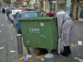 A drunk, ultra-Orthodox Jewish man leans over a rubbish container after a Jewish celebration. Because people engage in certain behaviour it doesn't mean that they are their preferred behaviours, says author Daniel Akst. (Menahem Kahana/AFP/Getty Images)