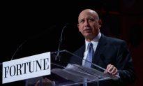 Goldman Reports Profit Drop, Cuts Compensation