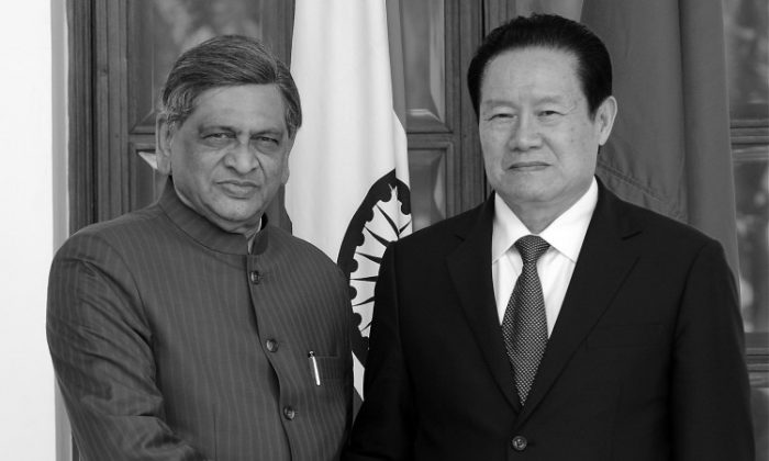 Indian Foreign Minister S M Krishna (L) shakes hands with Zhou Yongkang, ranked ninth in the hierarchy of the ruling Communist Party of China (CPC) and member of the influential Politburo Standing Committee in-charge of Political, Legal and Legislative Agenda prior to a meeting in New Delhi on Nov. 1, 2010. (Prakash Singh/AFP/Getty Images)