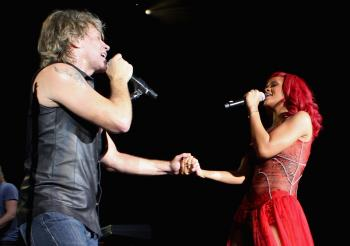 Jon Bon Jovi and Rihanna perform during a secret gig ahead of the MTV Europe Music Awards 2010 at the Teatro Circo Price on Nov. 6 in Madrid, Spain. (Dave J Hogan/Getty Images)