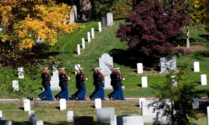 Members of the US Marine Corps Honor Guard march through Arlington National Cemetery in Arlington, Virginia, after participating in ceremonies marking Veteran's Day. (SAUL LOEB/AFP/Getty Images)