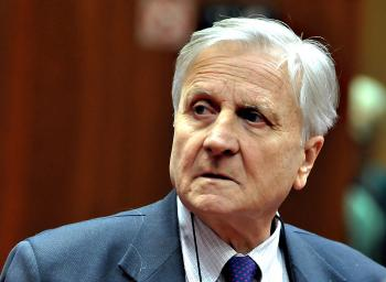 WORRIED: European Central Bank president Jean-Claude Trichet looks on at the ECOFIN Council meeting on Nov. 28 at the EU headquarters in Brussels. Economists fear that Ireland's recent financial woes may spread to other regional economies such as Italy and Spain. (Georges Gobet/AFP/Getty Images)