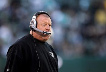 Oakland Raiders head coach Tom Cable walks the sidelines during the closing minutes of the team's loss to the Miami Dolphins, November 28, 2010 in Oakland, California. (Ezra Shaw/Getty Images )