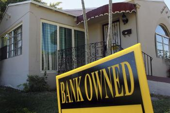 A bank owned sign is seen in front of a foreclosed home on December 7, 2010 in Miami, Florida.  (Joe Raedle/Getty Images)