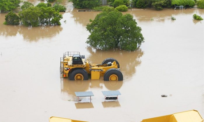 Mining equipment is submerged by flood waters on Jan. 6, 2011 in Rockhampton, Australia. (Jonathan Wood/Getty Images)