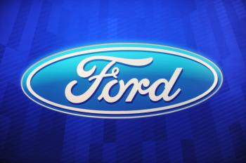 The Ford Motor Company logo is sen during the first press preview day at the 2011 North American International Auto Show January 10, 2011 in Detroit, Michigan. (Stan Honda/AFP/Getty Images)