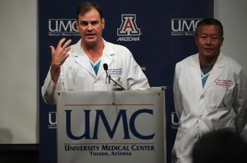 Gabrielle Giffords surviving: Dr. Michael Lemole, chief neurosurgeon at University Medical Center, speaks on Jan. 10, 2011 in Tuscon, Arizona. At right is trauma director Dr. Peter Rhee. (John Moore/Getty Images)