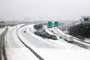 A snowy and icy view of I-20 in Atlanta is visible from a Marta train after a snow storm on January 10, 2011 in Atlanta, Georgia.  (Jessica McGowan/Getty Images)