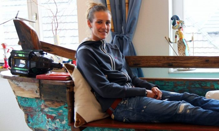 Simone Laudehr sits on an old bench in her living room during a photocall on October 6, 2010 in Straelen, Germany. (Lars Baron/Bongarts/Getty Images)