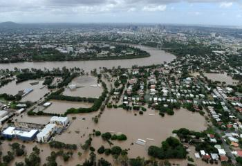 Queensland floods: Residential suburbs inundated by the swollen Brisbane River as flood waters devastate much of Brisbane on Jan. 13, 2011. (Torsten Blackwood/AFP/Getty Images)
