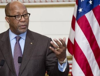 U.S. Trade Representative Ambassador Ron Kirk speaks during a panel discussion in Washington, D.C., on Jan. 13. The U.S. says Canada has been selling lumber for prices below those outlined in the timber pricing system grandfathered under the Softwood Lumb (Saul Loeb/AFP/Getty Images)