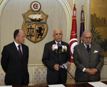 Tunisian Prime Minister Mohammed Ghannouchi (C) addresses the nation, flanked by Abdallah Kallel (L), president of the Chamber of Advisers of Tunisia and the President of the Tunisian Parliament Fouad Mbazaa, on January 14, 2011 that he had taken over as interim president after Zine El Abidine Ben Ali had left the country. (Fethi Belaid/Getty Images)