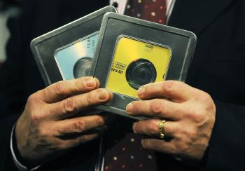 SENSITIVE DATA: Former Swiss banker Rudolf Elmer holds two CDs that he says contain a list of 2,000 companies and individuals that have possibly evaded taxes. Elmer personally handed the CDs over to founder of WikiLeaks Julian Assange on Monday. (CARL DE SOUZA/AFP/Getty Images)
