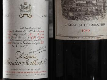 COUNTERFEIT WINES: A detailed view of labels on bottles of Chateau Mouton Rothschild 1959 and Chateau Lafite 1959, at Sotheby's Auction house Jan. 2011 in London, England. The growing demand for prestigious wine labels has given rise to a widespread count (Dan Kitwood/Getty Images)