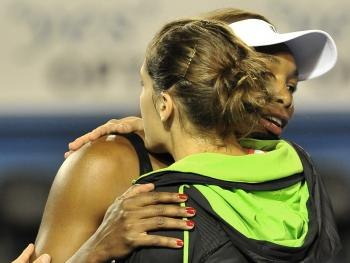 Venus Williams of the US (R) hugs Andrea Petkovic of Germany after retiring from her third round women's singles match on the fifth day of the Australian Open tennis tournament in Melbourne on January 21, 2011. (Paul Crock/AFP/Getty Images)