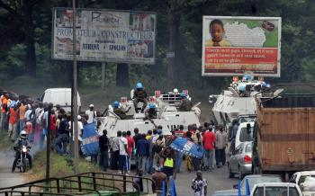 Supporters of incumbent Ivorian President Laurent Gbagbo block a convoy of UN peacekeepers on January 24 in Abidjan. Alassane Ouattara, internationally recognized as the winner of Ivory Coast's election, tried to choke off funding for his rival Laurent Gbagbo on Monday by ordering a halt to cocoa and coffee exports. (Issouf Sanogo/Getty Images )