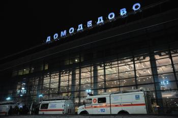 Vans of the Russian Emergencies Ministry wait outside Moscow's Domodedovo international airport on January 24, 2011, shortly after an explosion. A suspected suicide bombing on January 24 killed at least 35 people and wounded over 100 at the airport in an attack described by investigators as an act of terror.  (Andrey Smirnov/Getty Images )