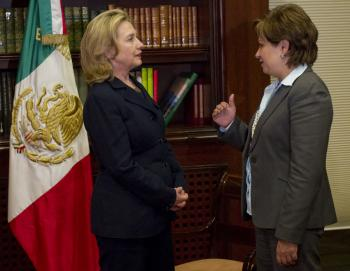 Mexican Foreign Minister Patricia Espinosa (R) talks with Hilary Clinton about border security and drug trafficking during a visit to Mexico City. (Saul Loeb/AFP/Getty Images)