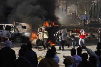Egyptian demonstrators burn a riot police car during a protest in the northern city of Suez on January 28, 2011 demanding the ouster of President Hosni Mubarak. (AFP/Getty Images)