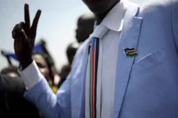 A man dressed in Southern Sudan style clothing wearing a pin and tie celebrating the announcement of the preliminary results of the Southern Sudan independence referendum in Juba on January 30, 2011. South Sudan voted overwhelmingly for independence from the north, with close to 99% in favor of secession. (Phil Moore/Getty Images )