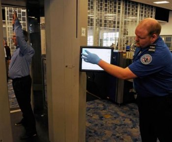 Transportation Security Administration (TSA) employees demonstrate an advanced image technology (AIT) millimeter wave scanner using new Automated Target Recognition software being tested by the TSA at McCarran International Airport February 1, 2011 in Las Vegas, Nevada.  (Ethan Miller/Getty Images)
