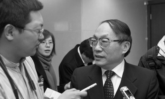 Photo taken on March 5, 2009 shows China's former railway minister Liu Zhijun (R) being interviewed in Beijing. (STR/AFP/Getty Images)