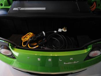 TESLA: A charging cable is seen in the trunk of a Tesla Roadster Sport Feb. 10 during the launch of the new Tesla showroom in Washington, DC. Tesla shares soared after an analyst upgrade on Thursday. (Mandel Ngan/AFP/Getty Images)