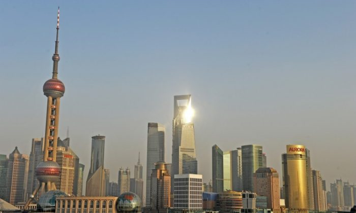 Skyscrapers in the financial district of Shanghai on Dec. 9, 2010. Hong Kong professor Larry Lang said in an Oct. 22, 2011 closed-door speech that all levels of government in Shanghai have gone bankrupt. (Philippe Lopez/AFP/Getty Images)