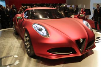 An Alfa Romeo 4C is displayed March 1 during the Geneva Motor Show in Geneva. The Milan-based automaker is set to re-enter the U.S. market beginning next year with its new lineup of sport models. (Sebastian Derungs/AFP/Getty Images)