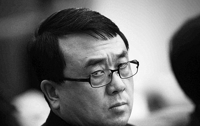 Wang Lijun, former Chief of Chongqing Public Security Bureau, attends a meeting during the annual National People's Congress at the Great Hall of the People on March 6, 2011 in Beijing, China (Photo by Feng Li/Getty Images)