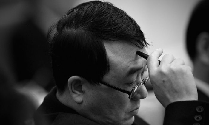 Wang Lijun, Chief of Chongqing Public Security Bureau, attends a meeting during the annual National People's Congress at the Great Hall of the People on March 6, 2011 in Beijing, China. (Feng Li/Getty Images)