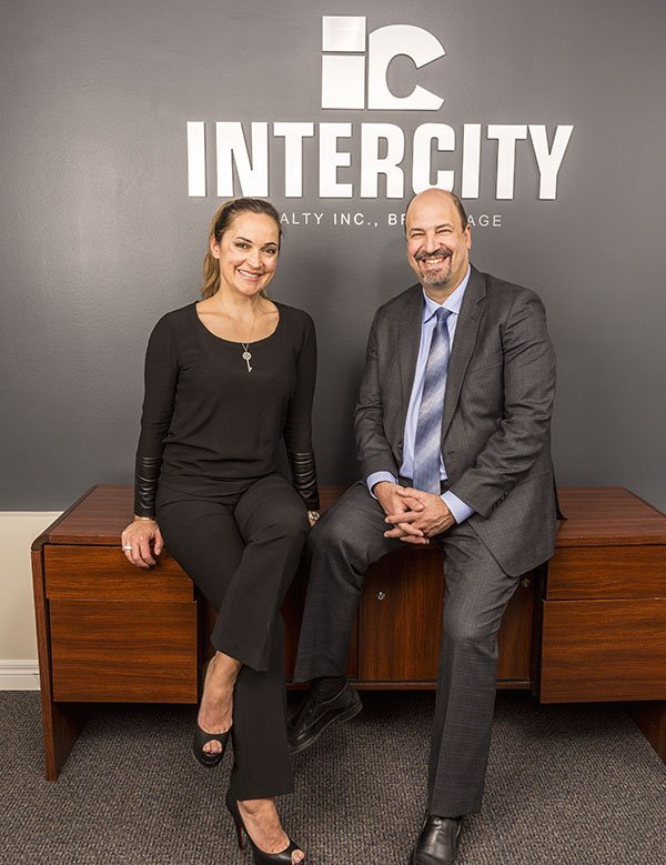 Marketing director Alda Neves Dubé and broker and manager Lou Grossi of Intercity Realty. (Courtesy of Intercity Realty/ City Life Magazine Vaughan Woodbridge)