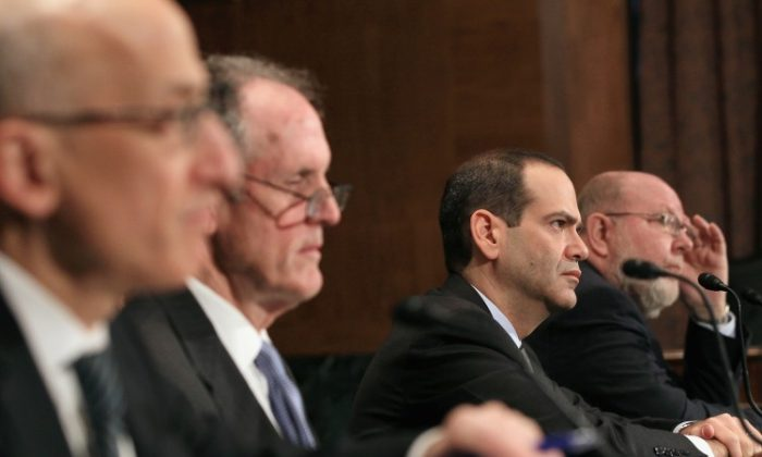 (L to R) Assistant Treasury Secretary Timothy Massad of the Office of Financial Stability, TARP Congressional Oversight Panel Chairman Ted Kaufman, Special Inspector General of the Troubled Asset Relief Program Neil Barofsky and Thomas McCool, participate in a hearing, on March 17, 2011 in Washington. The committee is hearing a testimony on oversight of the Troubled Asset Relief Program (TARP) and evaluating returns on taxpayer investments. (Mark Wilson/Getty Images)