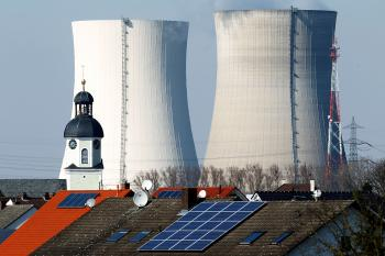 RETHINKING NUCLEAR: Steam rises from the cooling towers at a nuclear power plant on March 21 near Philippsburg, Germany, one of seven nuclear reactors built before 1980 that German Chancellor Angela Merkel has closed for safety and security reviews following the disaster at the Fukushima plant in Japan. (Thomas Niedermueller/Getty Images )