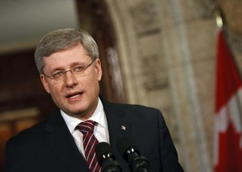 Canadian Prime Minister Stephen Harper speaks to the media at a press conference in the foyer of the House of Commons in Ottawa. A reporter asked Harper what he thought about people being ejected from his rallies in London and Guelph, Ontario. Harper responded by suggesting people were being turned away rather than ejected. (Geoff Robins/AFP/Getty Images)
