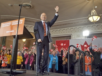 New Democratic Party leader Jack Layton waves during NDP's campaign kickoff event at the Chateau Laurier in Ottawa, Canada, on March 26. The latest poll released Wednesday by Forum Research showed that NDP was closing in on the front running Conservatives with 31 percent support compared to 34 percent for the Tories. (Geoff Robins/AFP/Getty Images)