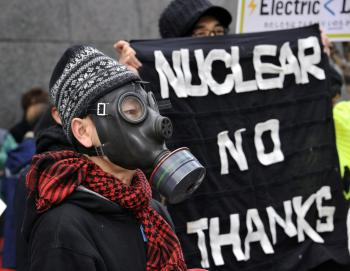 A protester wears a gas mask to protest against nuclear plants in front of the Tokyo Electric Power Co. headquarters in Tokyo on March 27. In light of the nuclear crisis continues in Japan, Physicians for Global Survival are calling for a moratorium on new nuclear reactors in Canada and a suspension of operations at existing reactors on fault lines. (Yoshikazu Tsuno/AFP/Getty Images)