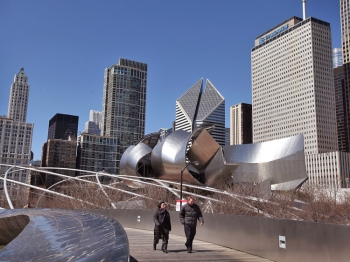 People walk past One Prudential Plaza (R) as it towers over the north end of Millennium Park on March 28, 2011 in Chicago, Illinois. (Scott Olsen/Getty Images )