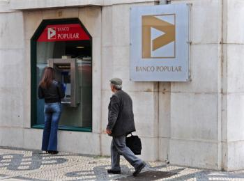A woman using a cash machine of the Banco Popular on March 29, 2011 in Lisbon, Portugal. (Jasper Juinen/Getty Images)