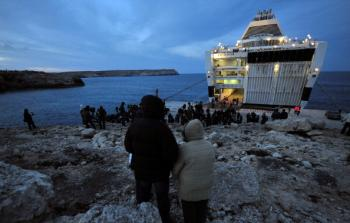 Tunisian would-be immigrants await to be transferred out of the Italian island of Lampedusa on March 30, 2011. (Alberto Pizzoli/AFP/Getty Images)