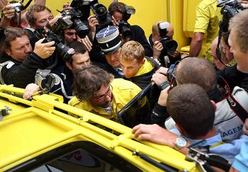 Riccardo Ricco (C) is taken away by French police after testing positive for EPO at the start of Stage Twelve of the 2008 Tour de France.  (Jasper Juinen/Getty Images )