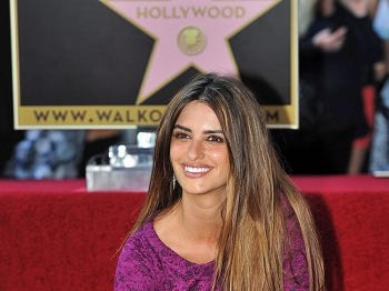 Actress Penelope Cruz poses in front of her very own star on the Hollywood Walk of Fame in Los Angeles, California, on April 1, 2011. (Gabriel Bouys/AFP/Getty Images)