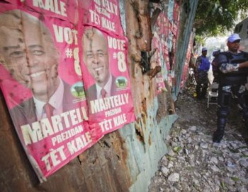 United Nations troops from India put on protective gear near posters of presidential candidate Michel 'Sweet Micky' Martelly near the headquarters of the Provision Electoral Council April 4, 2011 in Petionville, Haiti. (Lee Celano/Getty Images)